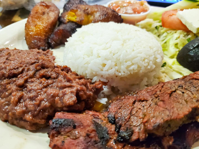 Yummy rice, beans, carne azada, plantain.
