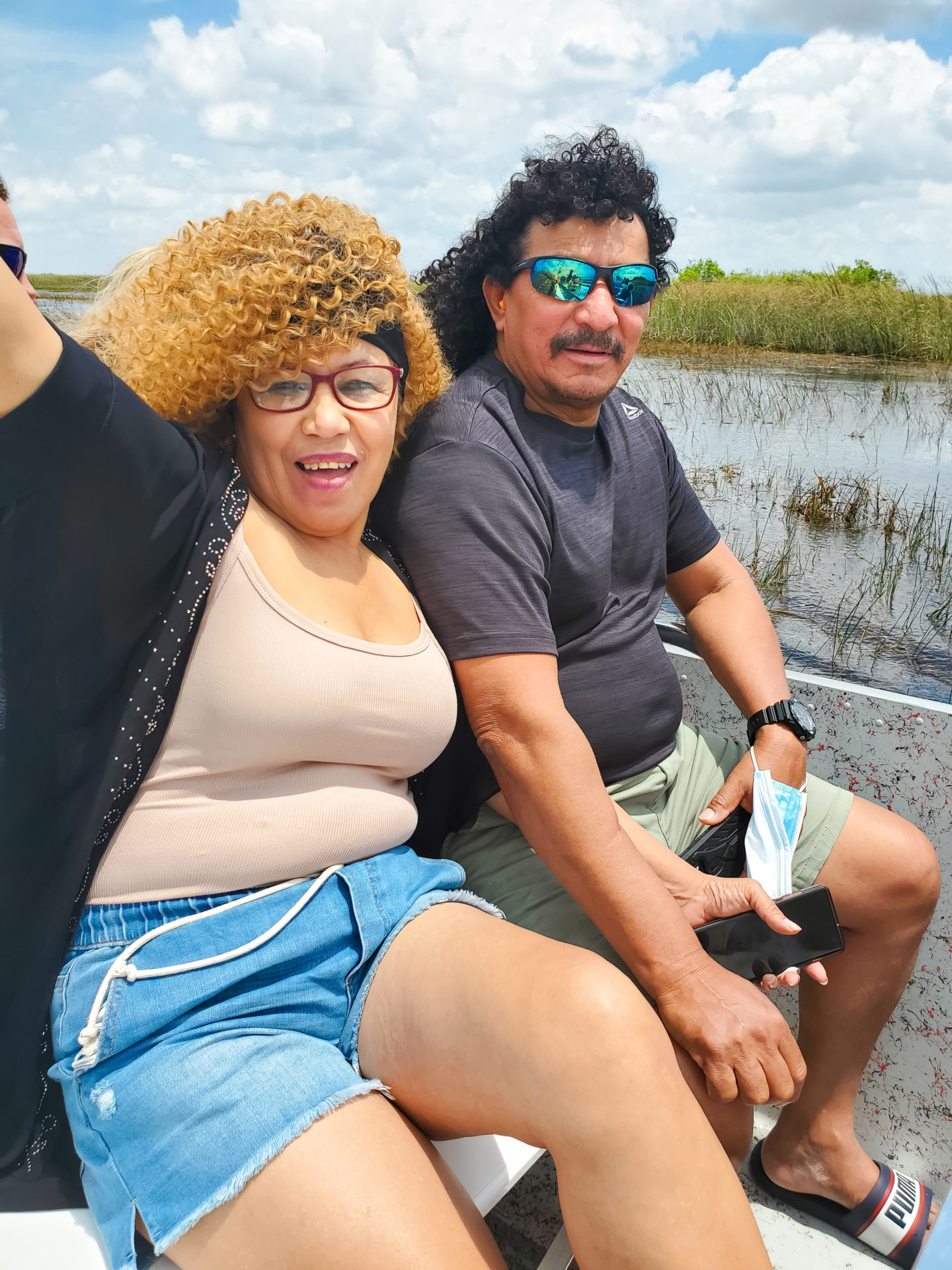 My mom and my dad enjoying the ride in the boat through the everglades.