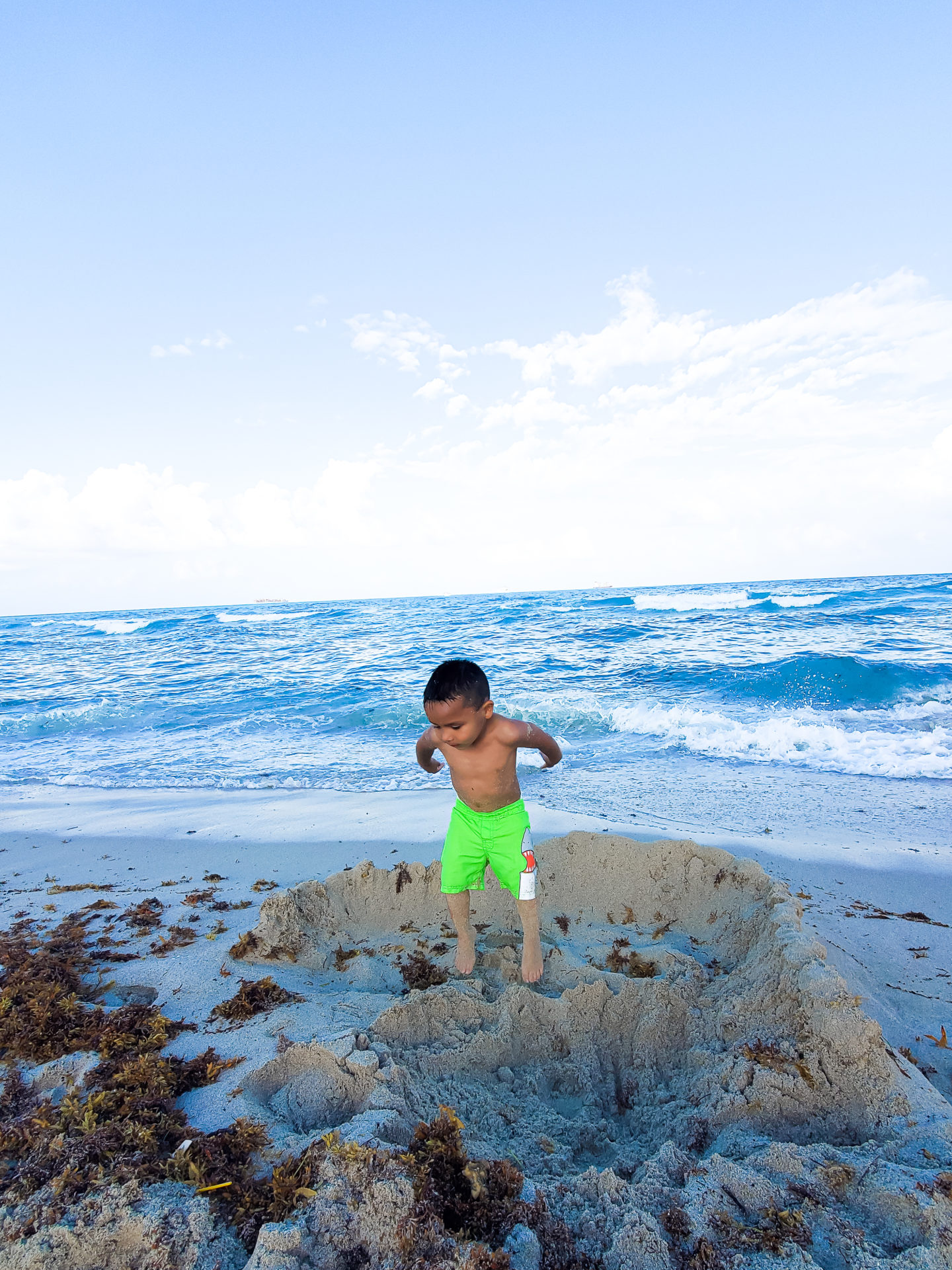 Liam Playing with his Sand Castle.
