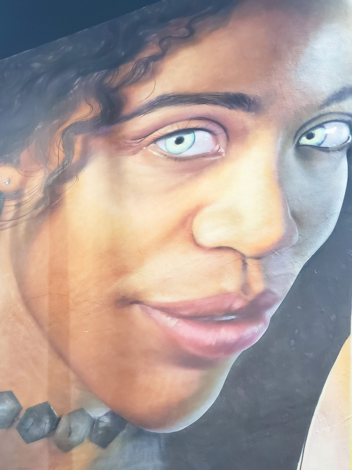 Beautiful Black Woman painted in a mural.